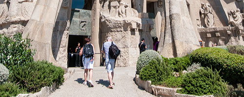 Sightseeing Barcelona, the Sagrada Familia: visitors making their way up to the entrance of the basilica of the Sagrada Familia.