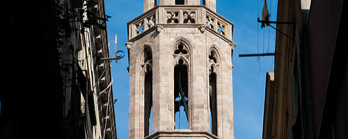 Sightseeing Barcelona, Santa Maria del Mar Church: an image of a section of the bell tower of the santa maria del mar church.