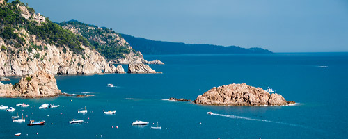 The costa brava with its cool blue waters and dramatic shoreline. Take a private day trip beyond Barcelona.