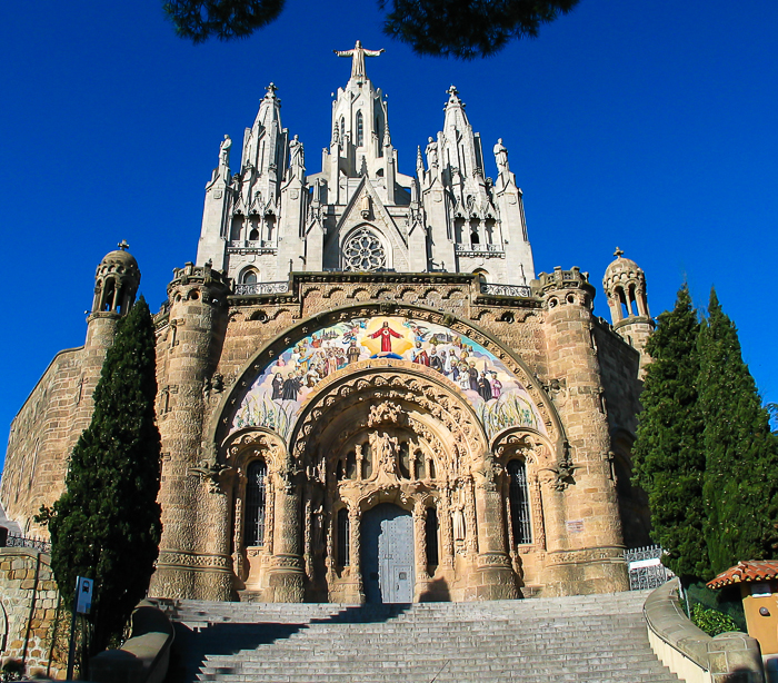 "The ""Temple del Sagrat Cor"" by its Catalan name, translates to the Church of the Sacred Heart and is actually two churches, one on top of the other as can be seen in this image."